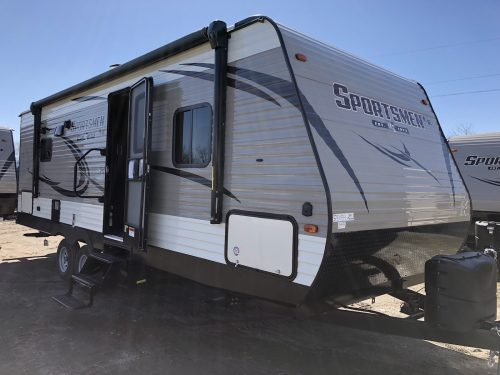 Exterior view of the 241RLLE Sportsmen LE with a Power Awning, pass throw front storage and outside speakers.