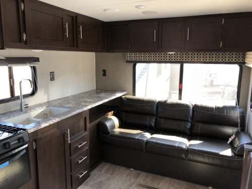 2019-Sportsmen-LE-241RLLE-Rear-Sofa-and-rv-kitchen