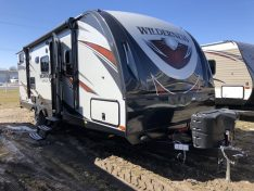 Exterior of the Wilderness 2475BH Featuring Slam Latch Baggage door and Fiberglass sidewalls