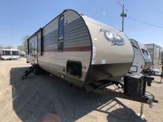Aluminum Exterior Cherokee travel trailer toy hauler.