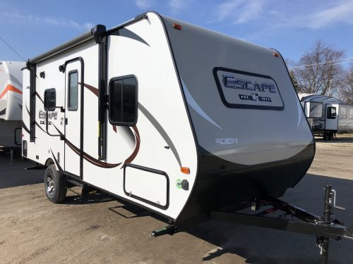 Fiberglass Exterior View of the Spree Escape 181RB with a power awning and outside speakers.