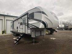 Fiberglass exterior view of the sportsmen Sportster 33ft fifth wheel toy hauler.