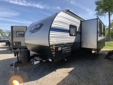 Off door side exterior view of the 26ft bunk house travel trailer by Cherokee RV.